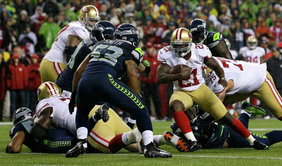 San Francisco 49ers' Frank Gore (21) rushes against Seattle Seahawks' Malcolm Smith (53) in the first half of an NFL football game, Sunday, Dec. 23, 2012, in Seattle. Photo: AP