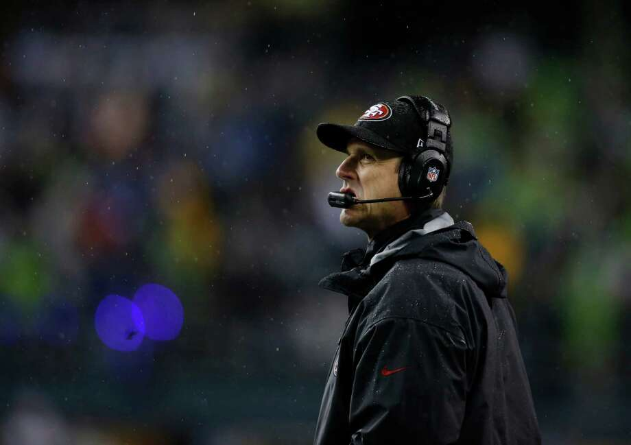 San Francisco 49ers' head coach Jim Harbaugh looks to the scoreboard in the first half of an NFL football game against the Seattle Seahawks, Sunday, Dec. 23, 2012, in Seattle. Photo: AP