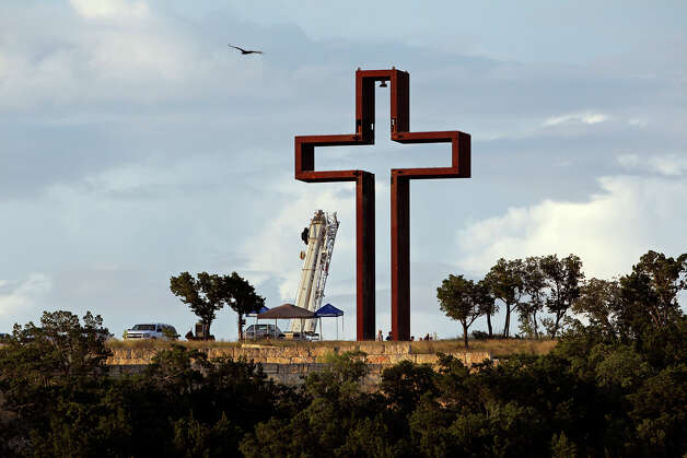 "Activities at Max Greiner's ""The Empty Cross"" at the Coming King Sculpture Prayer Garden in Kerrville in the evening on July 27, 2010. Photo: Tom Reel, San Antonio Express-News / © 2010 San Antonio Express-News"