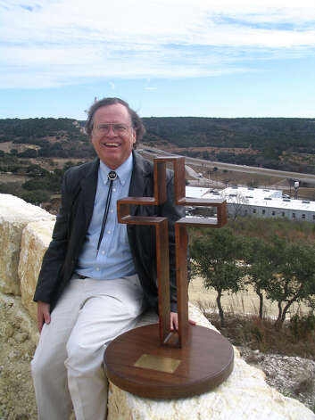 "Max Greiner Jr. plans to erect a 77-foot version of his sculpture ""The Empty Cross"" atop this hill overlooking Interstate 10 in Kerrville as part of the Coming King Sculpture Prayer Garden. Dec. 31, 2000. Photo: Zeke MacCormack, San Antonio Express-News / SAN ANTONIO EXPRESS-NEWS"