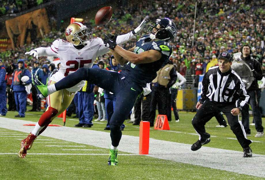 Seattle Seahawks' Jermaine Kearse, right, has a pass broken up by San Francisco 49ers' Tarell Brown (25) in the second half of an NFL football game, Sunday, Dec. 23, 2012, in Seattle. Photo: AP
