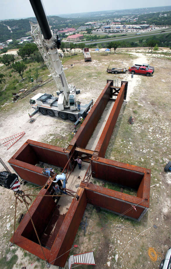 "Workers put the finishing touches on the supports of ""The Empty  Cross"" on July 26, 2010. The sculpture will be erected to overlook  Interstate 10 in sight of Kerrville by the Coming King Foundation. Photo: Bob Owen, San Antonio Express-News / rowen@express-news.net"