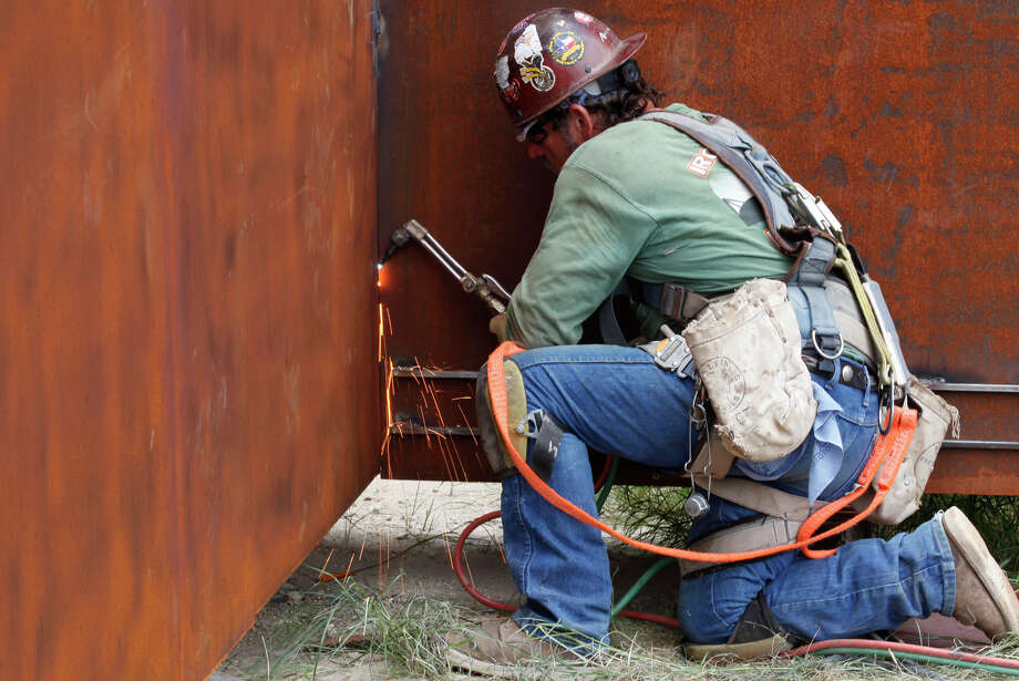 "Welder David Sellars of Debsteal Construction helps put the finishing touches on the support structures of ""The Empty Cross"" on July 26, 2010. The sculpture will be erected to overlook Interstate 10 in sight of Kerrville by the Coming King Foundation. Photo: Bob Owen, San Antonio Express-News / rowen@express-news.net"