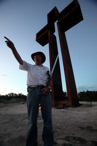 "Max Greiner recognizes friends during first night activities at his freshly installed ""The Empty Cross"" at the Coming King Sculpture Prayer Garden in Kerrville in the evening on July 27, 2010. Photo: Tom Reel, San Antonio Express-News / © 2010 San Antonio Express-News"