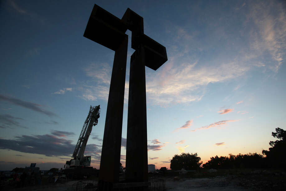 "Max Greiner's ""The Empty Cross"" stands at sunset at the Coming King Sculpture Prayer Garden in Kerrville in the evening on July 27, 2010. Photo: Tom Reel, San Antonio Express-News / © 2010 San Antonio Express-News"
