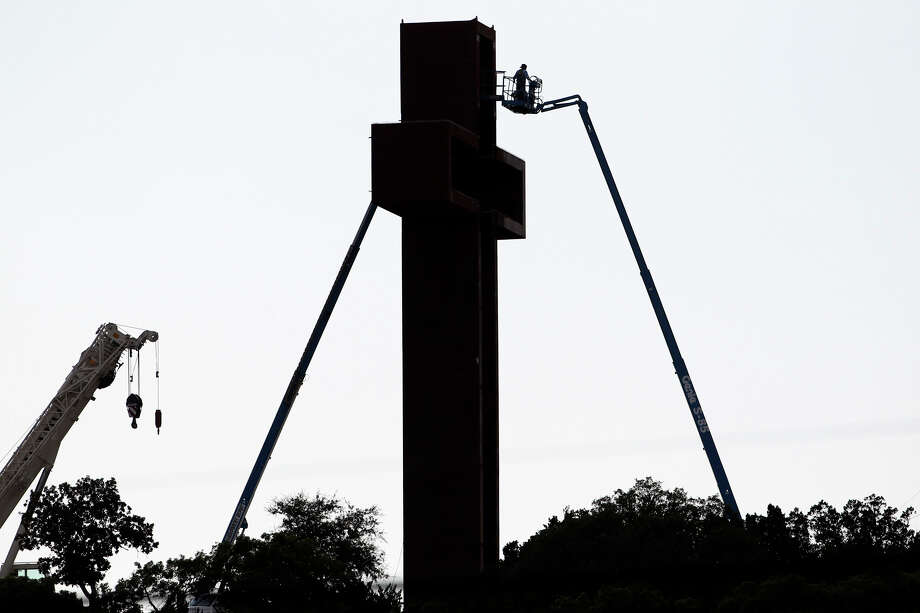 "Workers continue late in the day with installation of lighting before group activities at Max Greiner's ""The Empty Cross"" at the Coming King Sculpture Prayer Garden in Kerrville in the evening on July 27, 2010. Photo: Tom Reel, San Antonio Express-News / © 2010 San Antonio Express-News"
