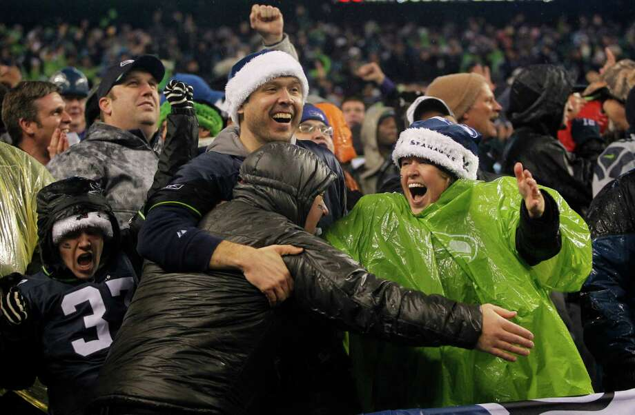 Seattle Seahawks fans celebrate a play against the San Francisco 49ers in the first half of an NFL football game, Sunday, Dec. 23, 2012, in Seattle. Photo: AP