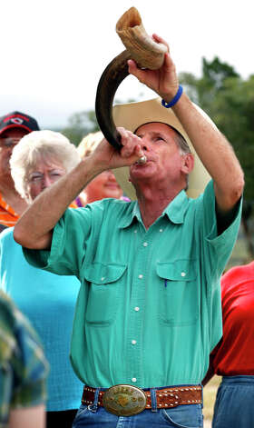 "James Barnett, of Impact Christian Fellowship Church, blows a Shofar during the raising of ""The Empty Cross,"" sponsored by the Coming King Foundation, at Interstate 10 and Texas 16 in Kerrville on July 27, 2010. Photo: Bob Owen, San Antonio Express-News / SAN ANTONIO EXPRESS-NEWS"