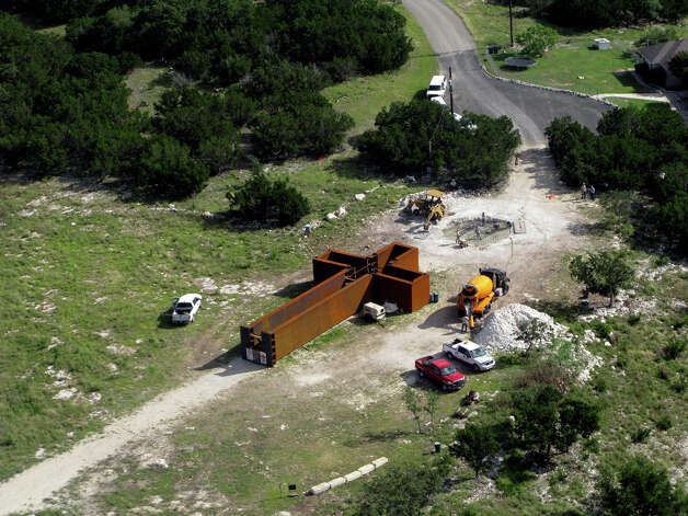 "Photo of ""The Empty Cross"" at the Coming King Sculpture Prayer Garden in Kerrville. Clint and Melissa Fiore made the photo on  June 18, 2010, as the concrete foundation was being poured. Photo: Melissa Fiore, Courtesy Photo / Melissa Fiore"