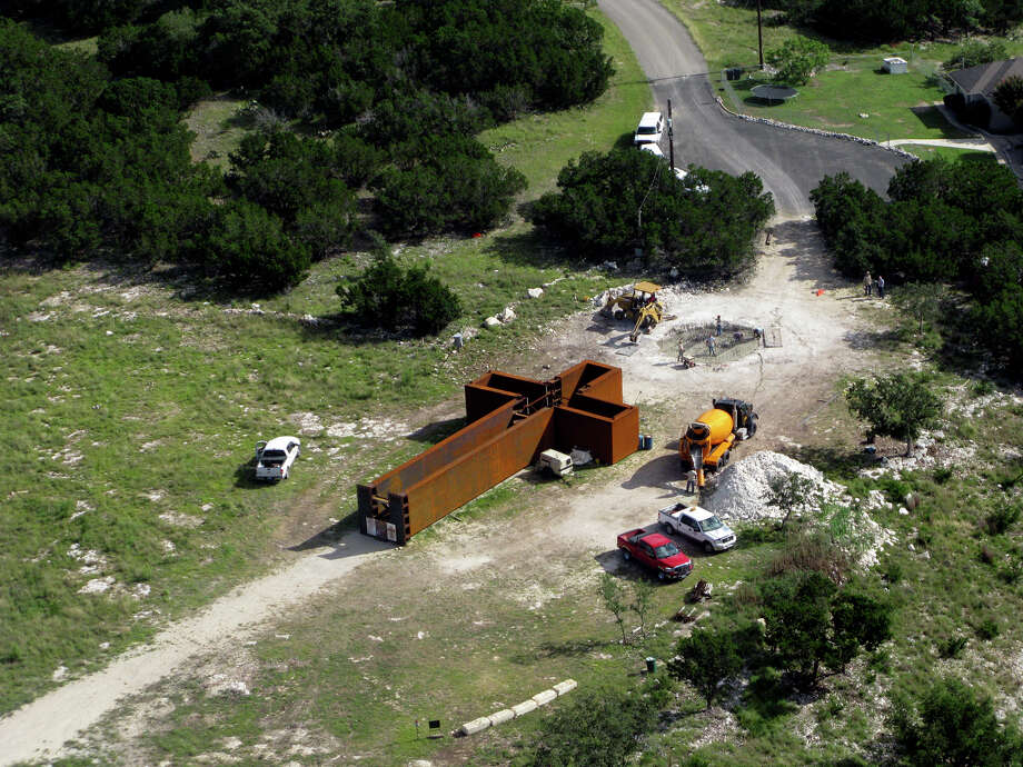 """Photo of """"The Empty Cross"""" at the Coming King Sculpture Prayer Garden in Kerrville. Clint and Melissa Fiore made the photo on June 18, 2010, as the concrete foundation was being poured. Photo: Melissa Fiore, Courtesy Photo / Melissa Fiore"""