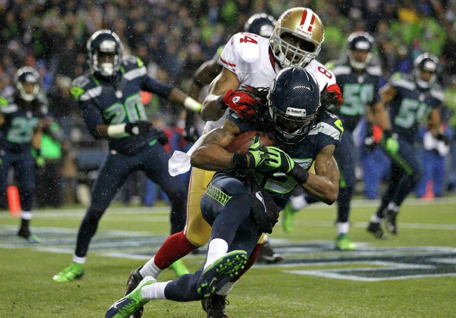 Seattle Seahawks' Richard Sherman comes down with an interception ahead of San Francisco 49ers' wide receiver Randy Moss in the second half of an NFL football game, Sunday, Dec. 23, 2012, in Seattle. The Seahawks beat the 49ers 42-13. Photo: AP