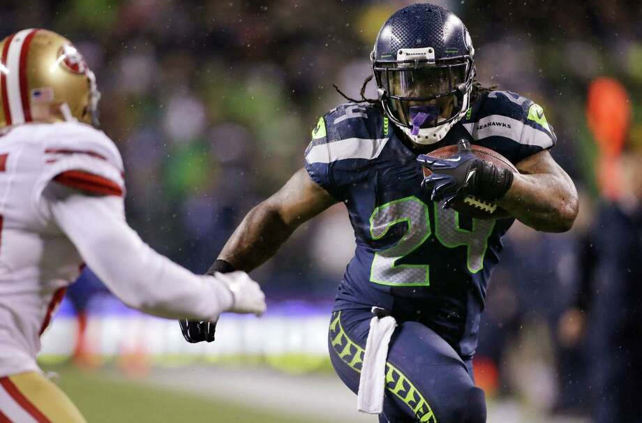 Seattle Seahawks' Marshawn Lynch (24) rushes against the San Francisco 49ers in the first half of an NFL football game, Sunday, Dec. 23, 2012, in Seattle. Photo: AP