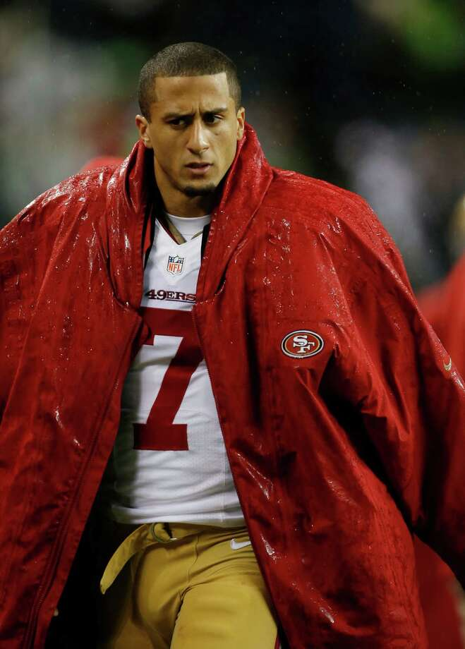 San Francisco 49ers quarterback Colin Kaepernick stands on the sideline in the first half of an NFL football game against the Seattle Seahawks, Sunday, Dec. 23, 2012, in Seattle. Photo: AP