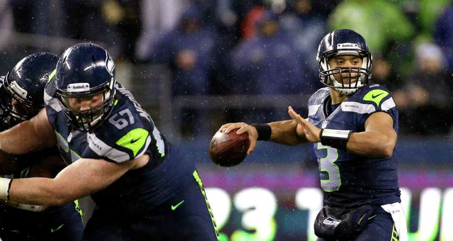 Seattle Seahawks quarterback Russell Wilson throws against the San Francisco 49ers in the first half of an NFL football game, Sunday, Dec. 23, 2012, in Seattle. Photo: AP