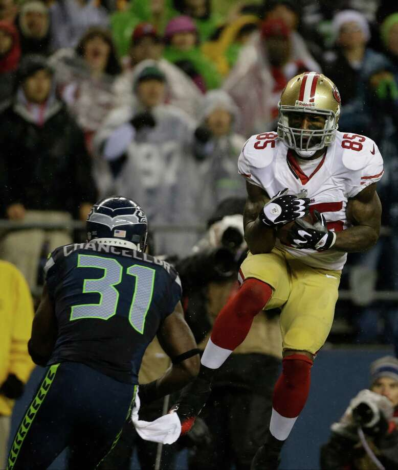 Seattle Seahawks' Kam Chancellor (31) moves to hit San Francisco 49ers' Vernon Davis on a reception attempt in the first half of an NFL football game, Sunday, Dec. 23, 2012, in Seattle. Photo: AP
