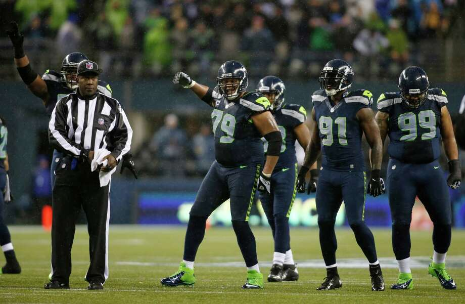 Seattle Seahawks Red Bryant (79), Chris Clemons (91) and Alan Branch (99) on the field against the San Francisco 49ers in the second half of an NFL football game, Sunday, Dec. 23, 2012, in Seattle. Photo: AP