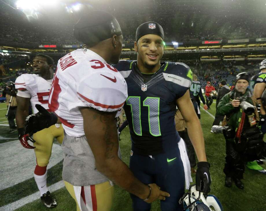 Seattle Seahawks' Jermaine Kearse (11) greets San Francisco 49ers' Dashon Goldson after an NFL football game, Sunday, Dec. 23, 2012, in Seattle. The Seahawks won 42-13. Photo: AP