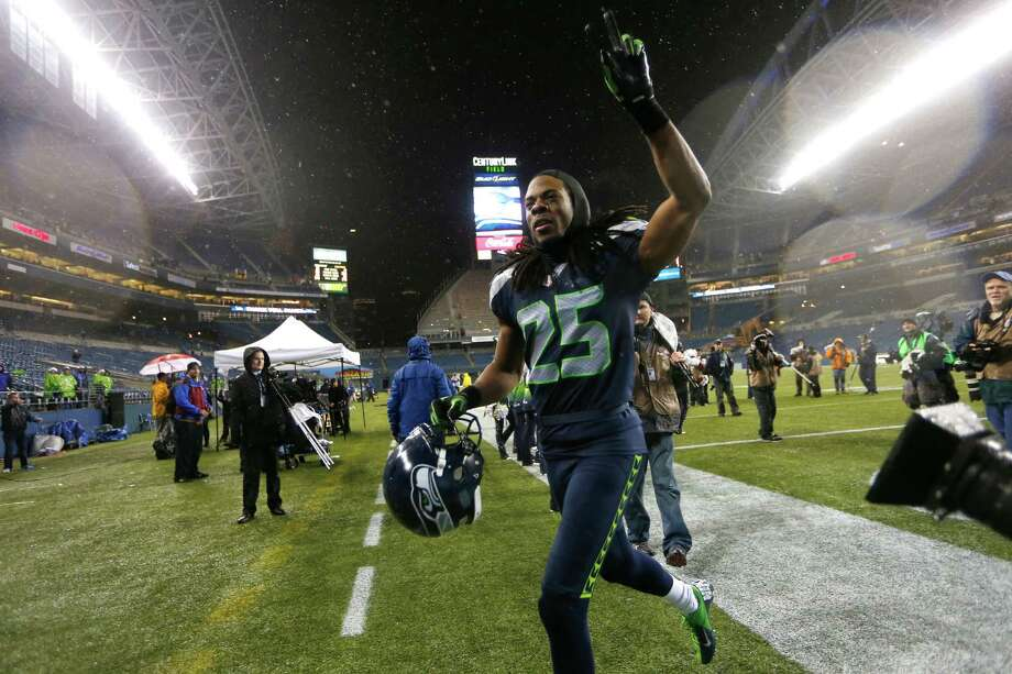 Seattle Seahawks Richard Sherman runs off the field after the Seahawks beat the San Francisco 49ers 42-13 in an NFL football game, Sunday, Dec. 23, 2012, in Seattle. Photo: AP