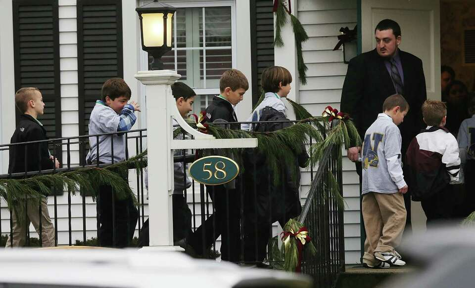NEWTOWN, CT - DECEMBER 17:  Boys walk to enter Honan Funeral Home before the funeral for 6-year-old