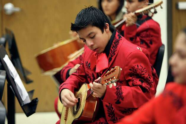 Jose Aleman along with other members of the mariachi program at Irving Academy rehearse on Tuesday Dec. 4, 2012 for their holiday program. Photo: Helen L. Montoya, San Antonio Express-News / ©SAN ANTONIO EXPRESS-NEWS
