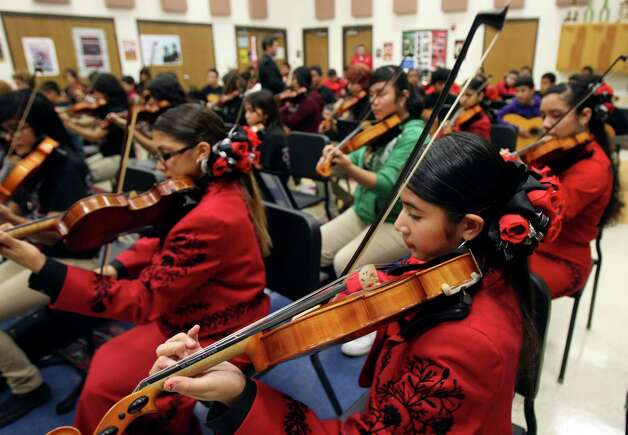 Michelle Campos, 13 and other students in the mariachi program at Irving Academy rehearse on Tuesday Dec. 4, 2012. Photo: Helen L. Montoya, San Antonio Express-News / ©SAN ANTONIO EXPRESS-NEWS