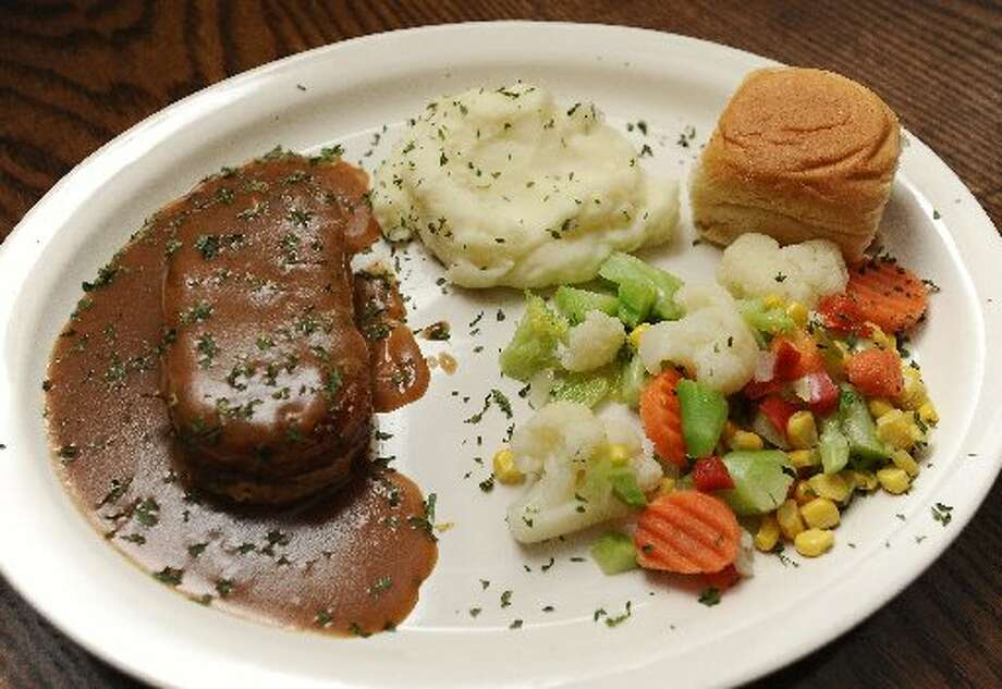 Wednesdays special will keep you drolling for more with pork loin roast, mashed potatoes, and veggies at Romero's. Randy Edwards/cat5