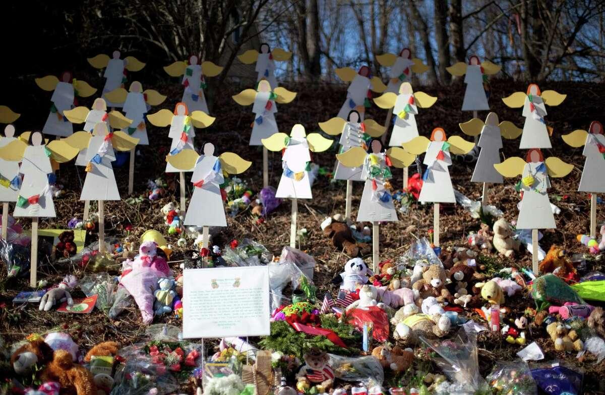 A memorial is shown on Highway 34 in Sandy Hook.