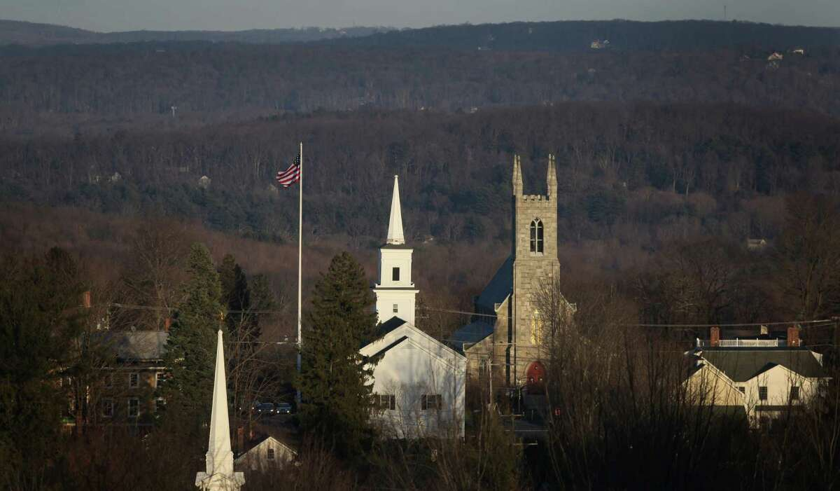 The flag in the center of Newtown flies at full mast as seen from Old Castle Drive on Sunday, December 23, 2012, nine days after 28 people were killed during a day of violence in Newtown.