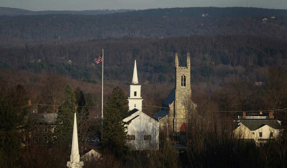 The flag in the center of Newtown flies at full mast as seen from Old Castle Drive on Sunday, December 23, 2012, nine days after 28 people were killed during a day of violence in Newtown. Photo: JOSHUA TRUJILLO / HEARST NEWSPAPERS