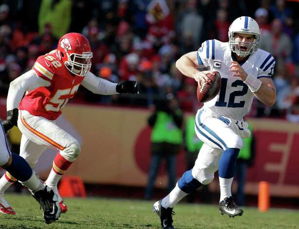 Indianapolis Colts quarterback Andrew Luck, right, scrambles away from Kansas City Chiefs inside linebacker Brandon Siler during the first half of an NFL football game on Sunday, Dec. 23, 2012, in Kansas City, Mo. (AP Photo/Charlie Riedel) Photo: Charlie Riedel