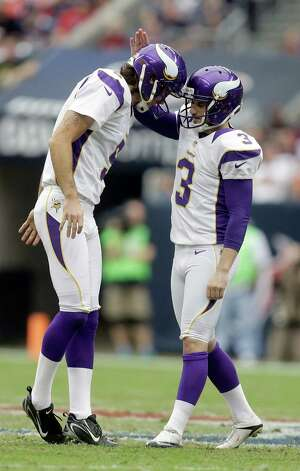 Minnesota Vikings' Blair Walsh (3) is congratulated by Chris Kluwe (5) after kicking a 56-yard field goal against the Houston Texans during the second quarter of an NFL football game Sunday, Dec. 23, 2012, in Houston. (AP Photo/Patric Schneider) Photo: Patric Schneider