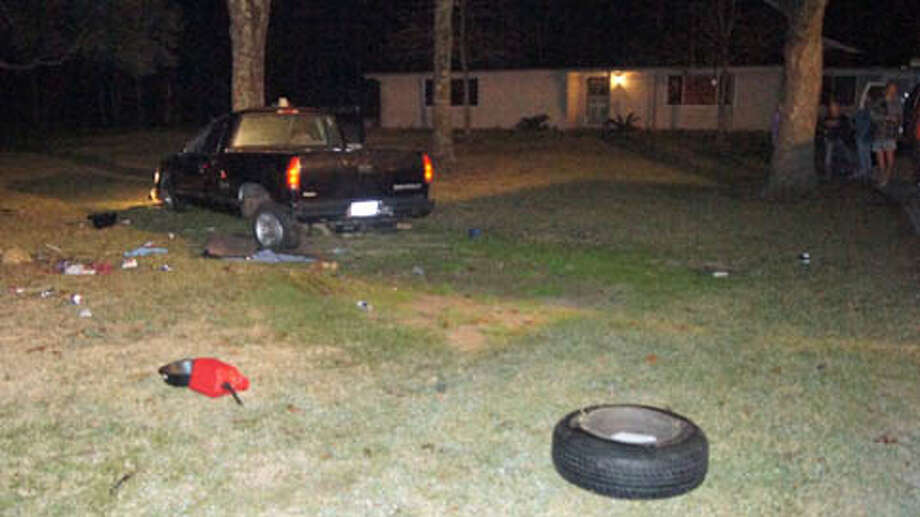 A 25-year-old woman died and her passenger, also a 25-year-old woman, suffered minor injuries just after midnight Monday when their 1997 Chevrolet pickup left the road and flipped in the front yard of a home in the 700 block of Whippoorwill, east of Conroe and north of Texas 105. (Scott Engle / Montgomery County Police Reporter) Photo: Montgomgery County Police Reporter