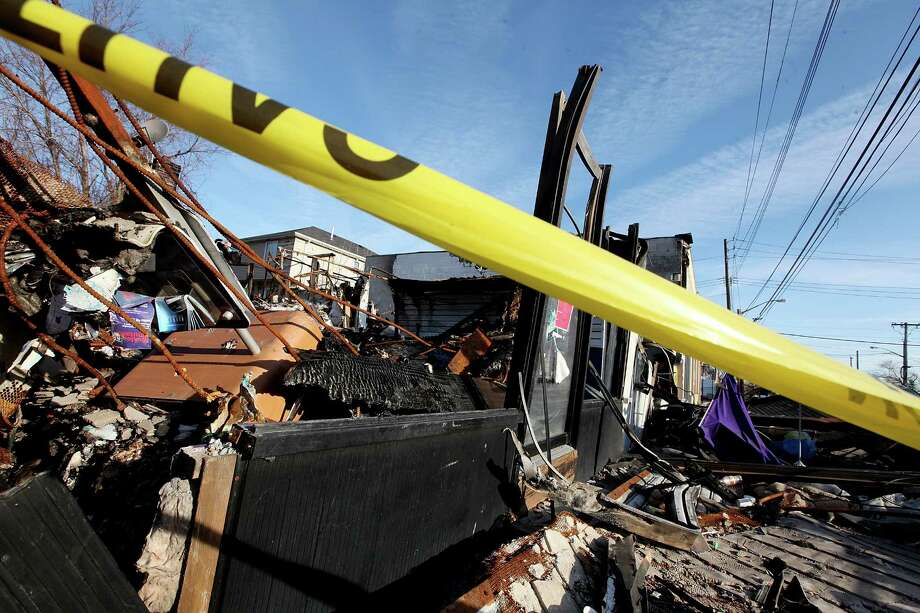 NEW YORK, NY - DECEMBER 23:  A property destroyed by fire following Superstorm Sandy remains blocked by police tape in the Midland Beach neighborhood which was heavily damaged by Sandy on December 23, 2012 in the Staten Island borough of New York City. Staten Island was hit hard by Sandy and some homes and businesses remain without power. Photo: Mario Tama, Getty Images / 2012 Getty Images