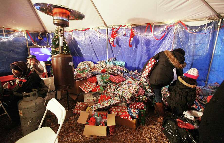 NEW YORK, NY - DECEMBER 23:  Residents colect free presents in a distribution relief tent for those affected by Superstorm Sandy on December 23, 2012 in the Staten Island borough of New York City. Staten Island was hit hard by Sandy and some homes and businesses remain without power. Photo: Mario Tama, Getty Images / 2012 Getty Images