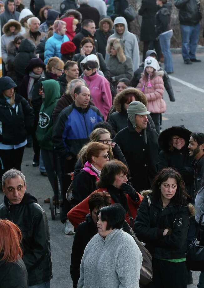 NEW YORK, NY - DECEMBER 23:  People wait on line to shop for free items at a pop-up shopping event organized by Fashion Delivers for victims of Hurricane Sandy on December 23, 2012 in the Staten Island borough of New York City. The two-day event was expected to draw 1,000 people to holiday shop for free unused donated apparel. Staten Island was hit hard by Hurricane Sandy. Photo: Mario Tama, Getty Images / 2012 Getty Images