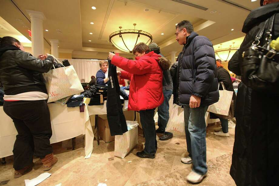NEW YORK, NY - DECEMBER 23:  People shop for free items at a pop-up holiday shopping event organized by Fashion Delivers for victims of Superstorm Sandy on December 23, 2012 in the Staten Island borough of New York City. The two-day event was expected to draw 1,000 people to holiday shop for free unused donated apparel. Staten Island was hit hard by Sandy. Photo: Mario Tama, Getty Images / 2012 Getty Images