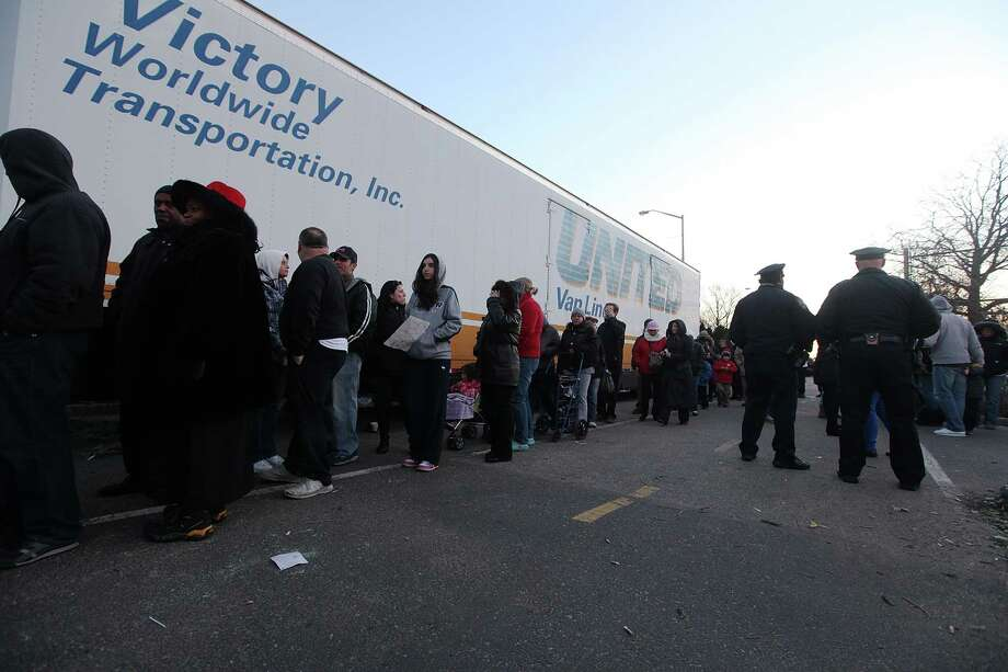 NEW YORK, NY - DECEMBER 23:  People wait on line to shop for free items at a pop-up holiday shopping event organized by Fashion Delivers for victims of Superstorm Sandy on December 23, 2012 in the Staten Island borough of New York City. The two-day event was expected to draw 1,000 people to holiday shop for free unused donated apparel. Staten Island was hit hard by Sandy. Photo: Mario Tama, Getty Images / 2012 Getty Images