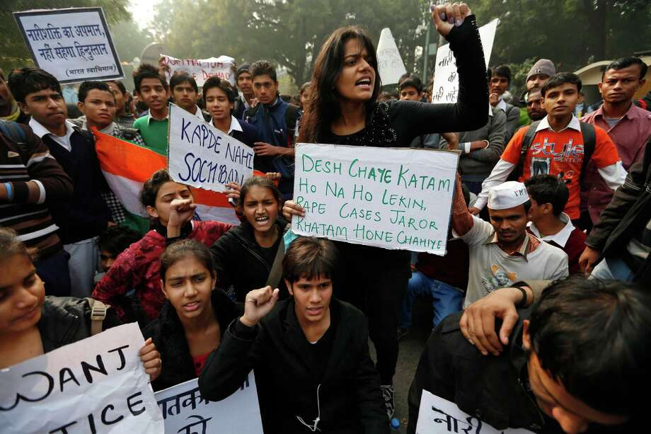 "Indian students carrying placards shout slogans against last week's gang-rape as they protest in central New Delhi, India, Monday, Dec. 24, 2012. Authorities shut down roads in the heart of India's capital on Monday to put an end to a week of demonstrations against the brutal gang-rape of a woman on a moving bus. The placards reads; ""Change attitude towards women and not the way they dress,"" ""India will not withstand insult to women,"" and  ""whether the country ends or not all rape cases should come to an end."" Photo: Saurabh Das, AP / AP"