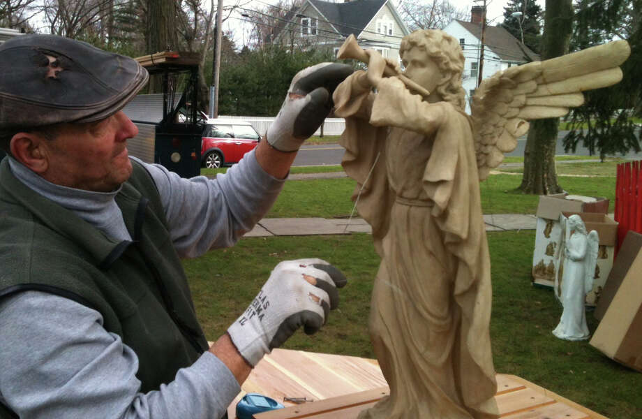 Tom Kapitan of Fairfield, a member of the Knights of Columbus at Holy Family Church, prepares an angel figure for the Nativity creche set up on Town Hall Green.  Fairfield CT 12/23/12 Photo: Andrew Brophy / Fairfield Citizen contributed