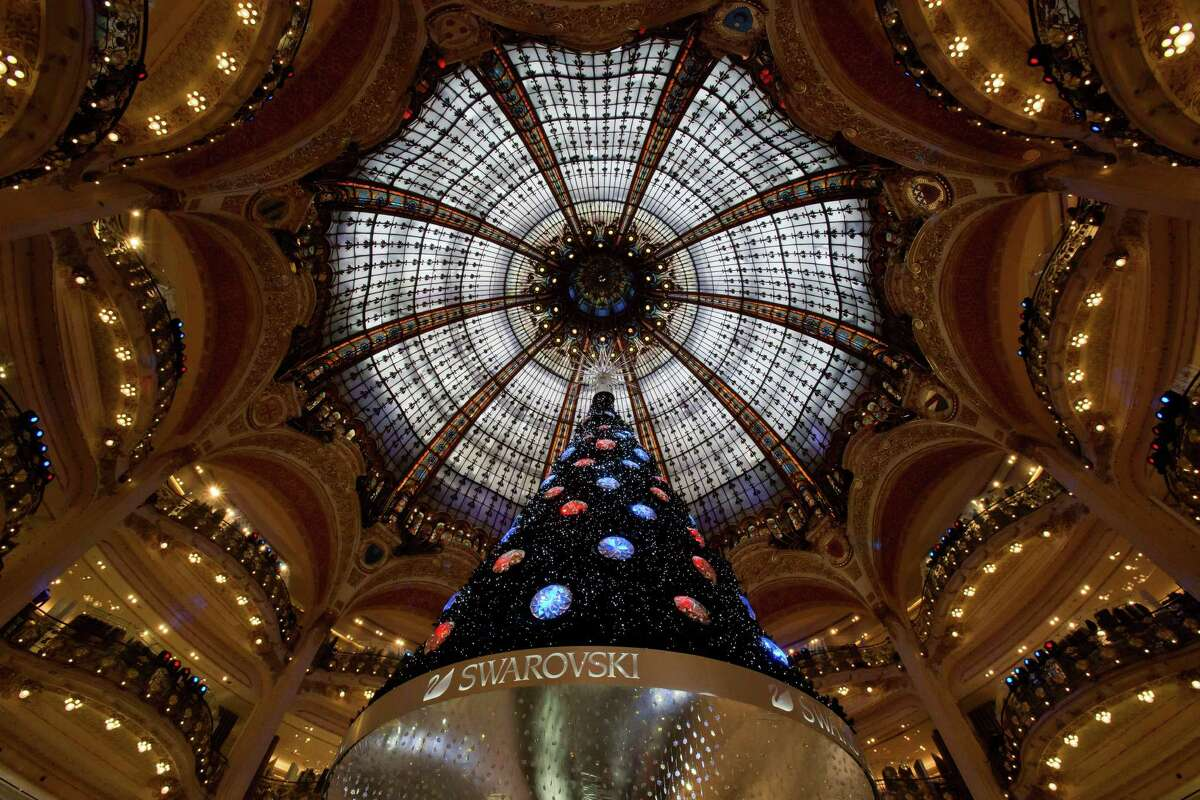 A Christmas tree is seen in the main hall of the Galeries Lafayette department store in Paris, Tuesday, Dec. 18, 2012.