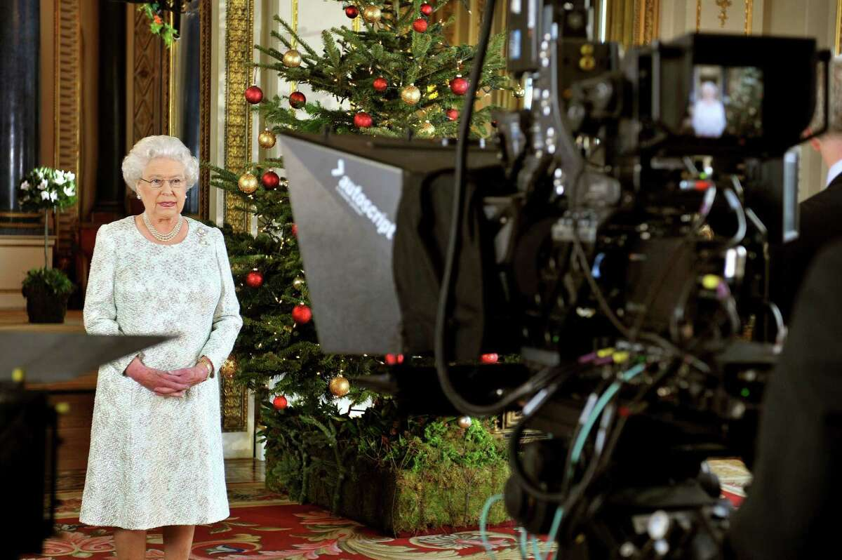 TOPSHOTS Queen Elizabeth II records her Christmas message to the Commonwealth which is to be broadcast in 3D for the first time, in the White Drawing Room at Buckingham Palace in London on December 23, 2012. AFP PHOTO/POOL/ John StillwellJOHN STILLWELL/AFP/Getty Images