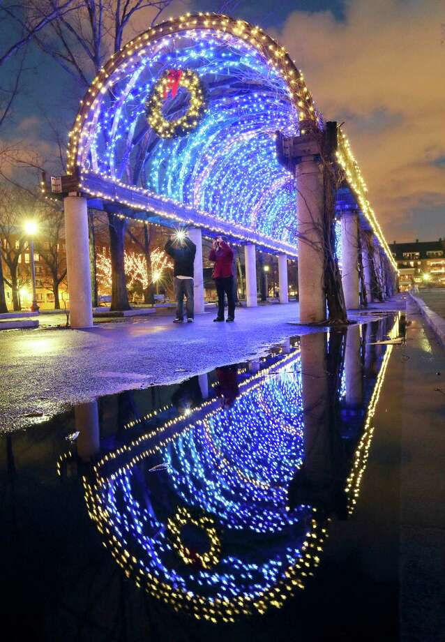 Holiday lights adorn a walkway in Christopher Columbus park on the waterfront in Boston, Friday, Dec. 21, 2012. Photo: Michael Dwyer, AP / AP