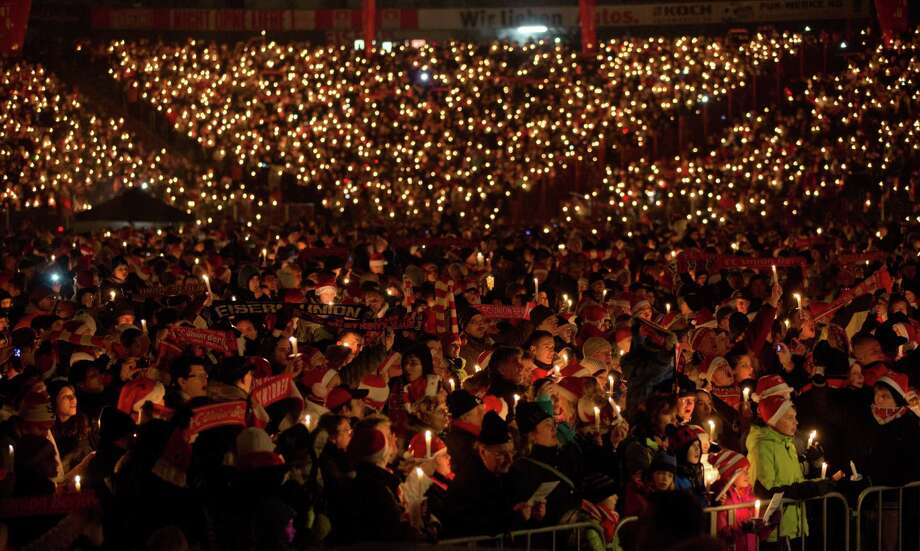 Supporters of the German second division football club FC Union Berlin attend the 10th Christmas singing at Stadium Alte Foersterei in Berlin, on December 23, 2012. For two hours, more than 20000 people sang Christmas songs. AFP PHOTO / Jörg Carstensen   GERMANY OUTJörg Carstensen/AFP/Getty Images Photo: JÖRG CARSTENSEN, AFP/Getty Images / DPA