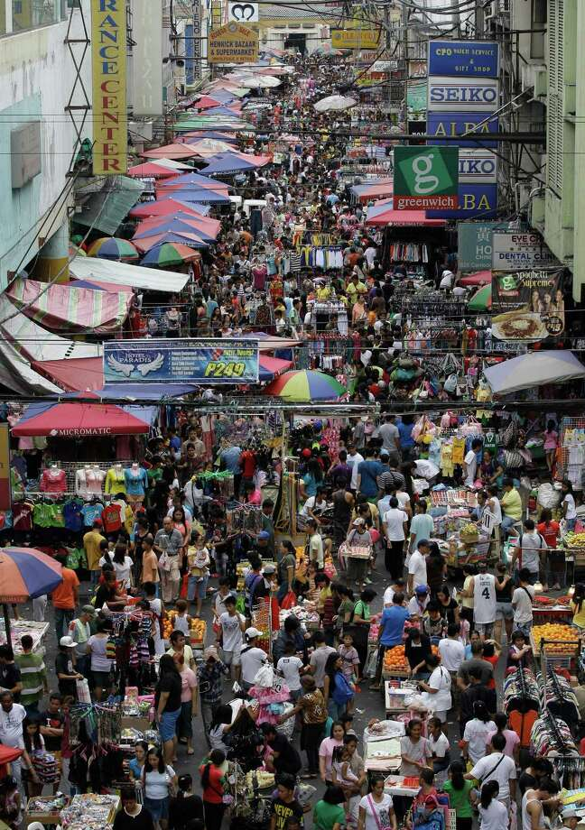 Filipinos crowd along makeshift stalls along a road in downtown Manila, Philippines as they make their last-minute shopping on Christmas eve, Monday Dec. 24, 2012. Christmas is one of the most important holidays in this predominantly Roman Catholic nation. Photo: Aaron Favila, AP / AP