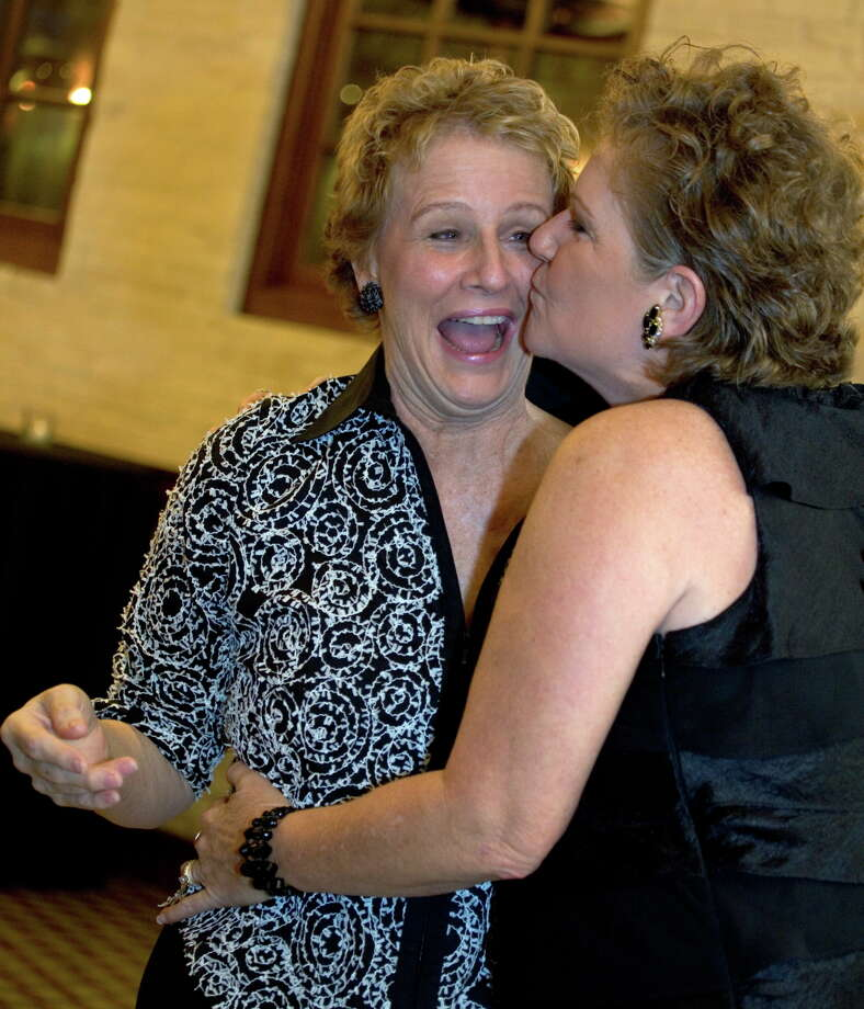 OTS/TRENDS/HEIDBRINK Honoree Louise Locker receives a kiss on the cheek from South San Antonio Chamber of Commerce President Cindy Taylor at the South San Antonio Chamber of Commerce Legends Gala at the Pearl Stable. Photo by Jamie Karutz. Photo: Jamie Couch Karutz, SPECIAL TO THE EXPRESS-NEWS / SAN ANTONIO EXPRESS-NEWS