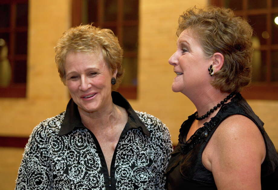 OTS/TRENDS/HEIDBRINK Honoree Louise Locker sports a new hairdo after receiving chemotherapy treatments. She shares a laugh with South San Antonio Chamber of Commerce President Cindy Taylor at the Chamber's Legends Gala at the Pearl Stable. Photo by Jamie Karutz. Photo: Jamie Couch Karutz, SPECIAL TO THE EXPRESS-NEWS / SAN ANTONIO EXPRESS-NEWS