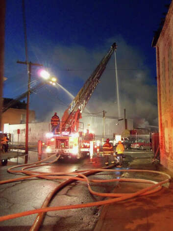 Bridgeport, Conn. firefighters battle a blaze at 33 Knowlton St. on Dec. 24, 2012. Photo: John Burgeson