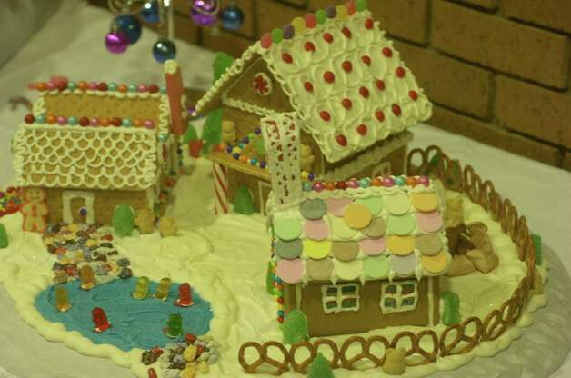 "Gingerbread houses are displayed at Journey Community Church's ""Journey to the North Pole"" Sunday in Lumberton. Photo: Avi Zaleon"