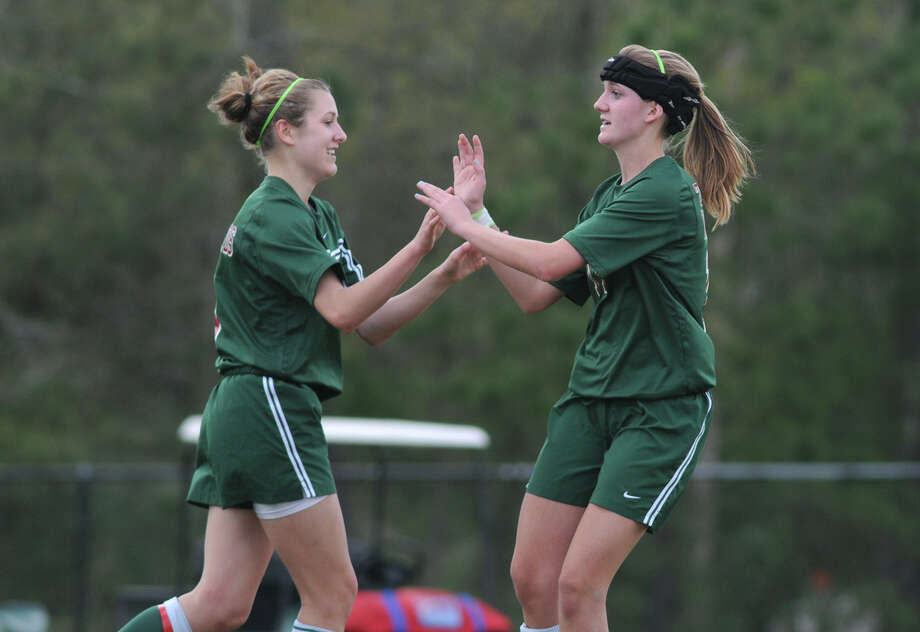 The Woodlands' Kaleigh Olmsted, left, was congratulated after scoring a goal by former teammate Hannah Stanifer during the team's run to the 5A state championship in 2010. Olmsted logged 10 goals and 10 assists that season. Photo: Jerry Baker, Freelance / Freelance