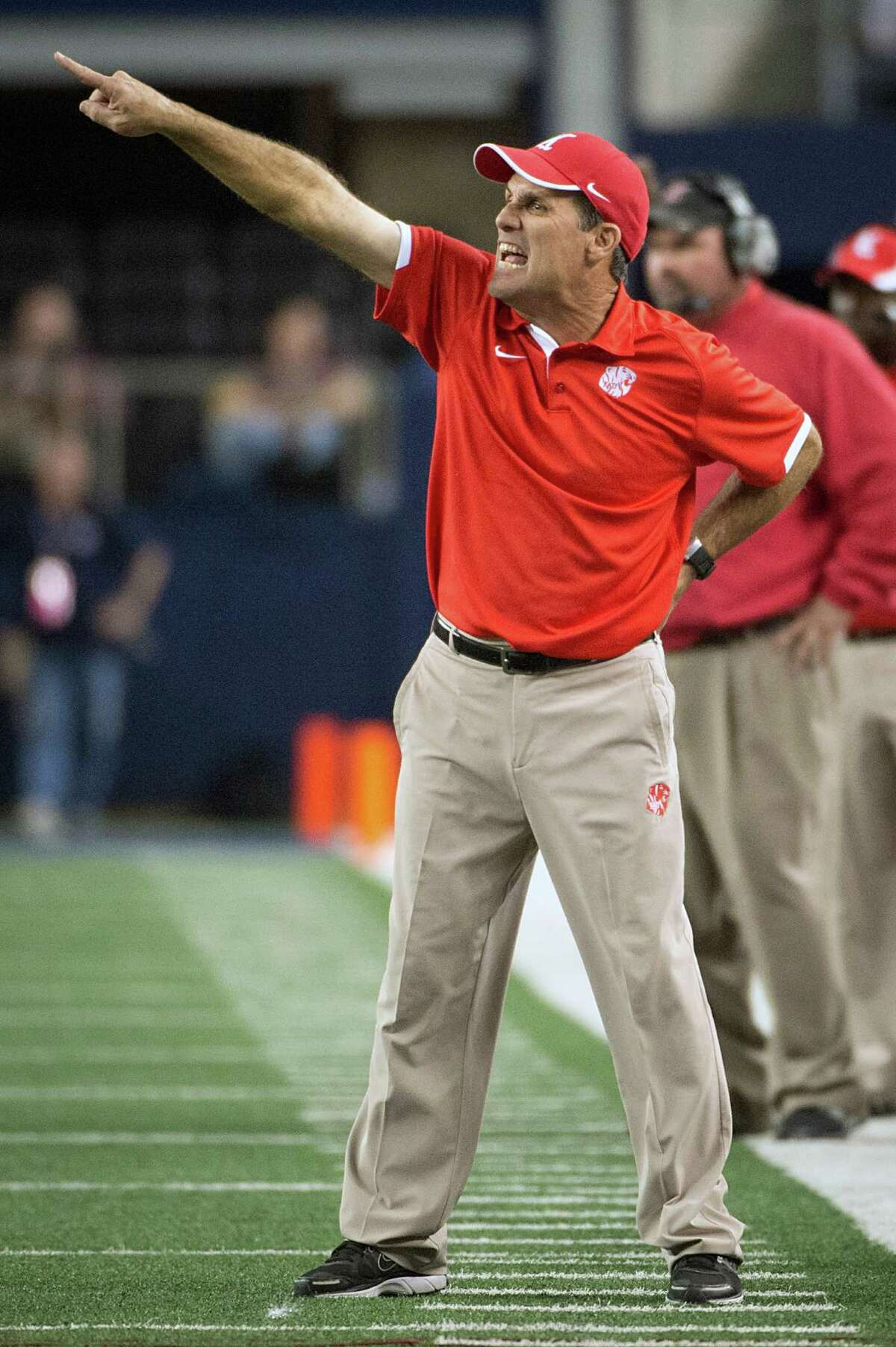 Katy head coach Gary Joseph directs his team during the second half of the Class 5A Division II state championship football game against Cedar Hill at Cowboys Stadium on Saturday, Dec. 22, 2012, in Arlington. ( Smiley N. Pool / Houston Chronicle )